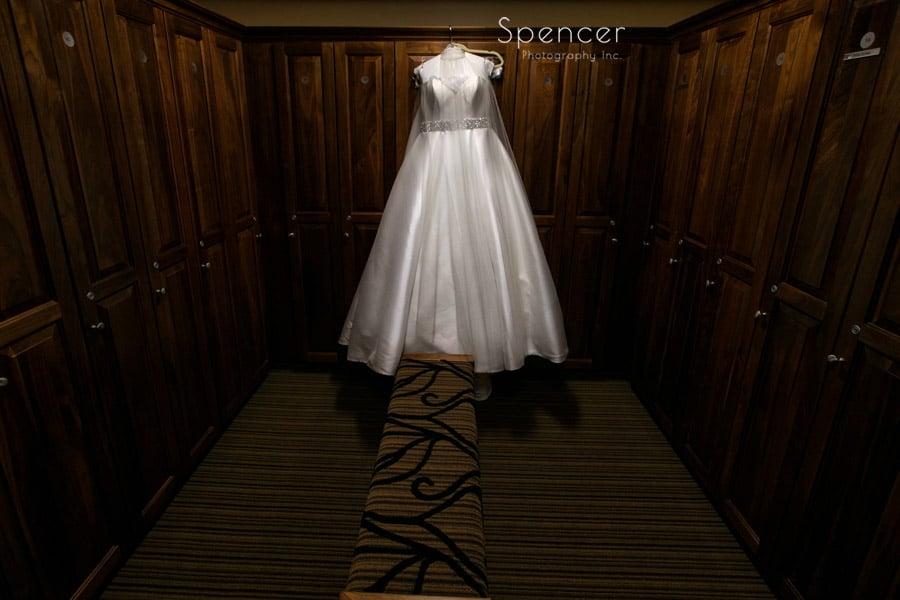 wedding dress hanging in Firestone Country Club lockerroom