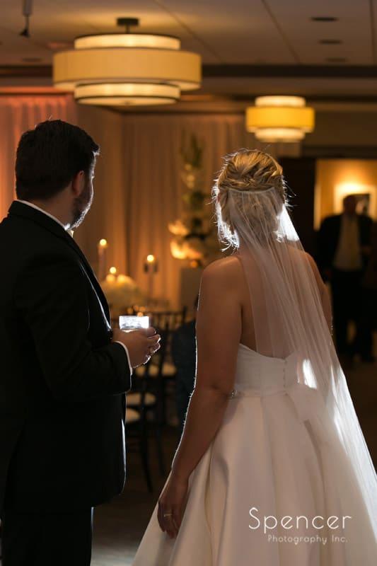 bride and groom enjoying their wedding reception at Firestone Country Club