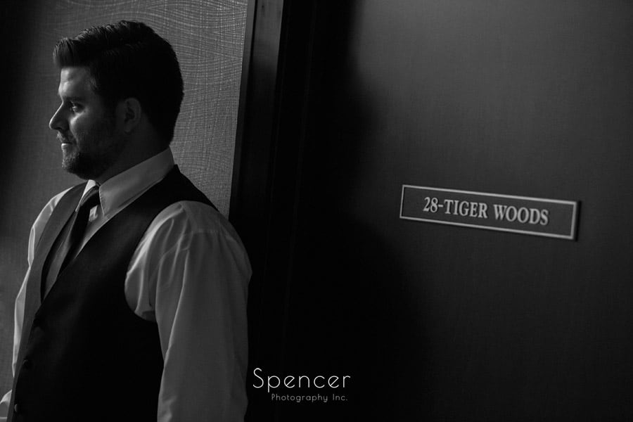 groom by the Tiger Woods room on wedding day at Firestone