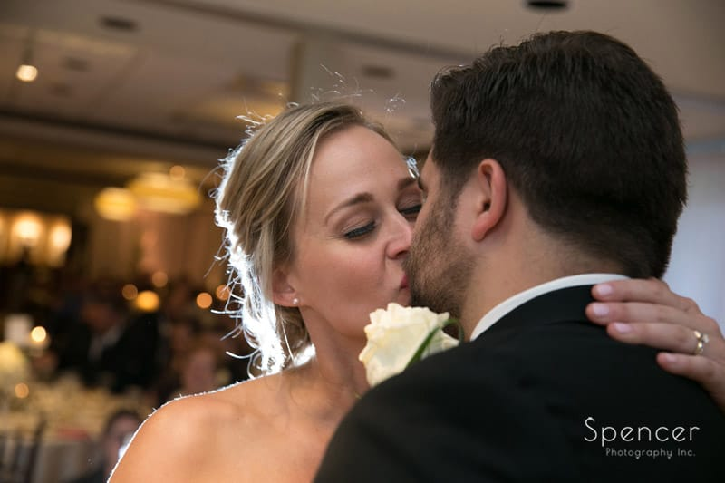 bride kisses groom during first dance at firestone
