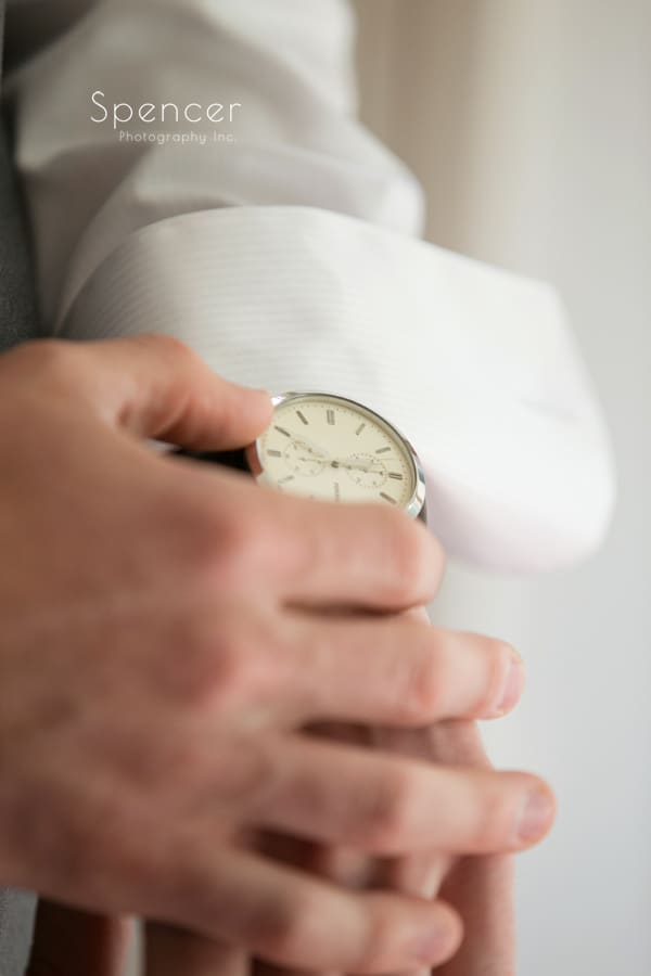 groom adjusting his watch