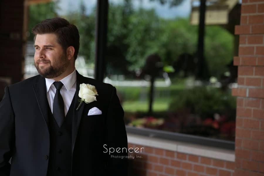wedding portrait of groom at firestone country club