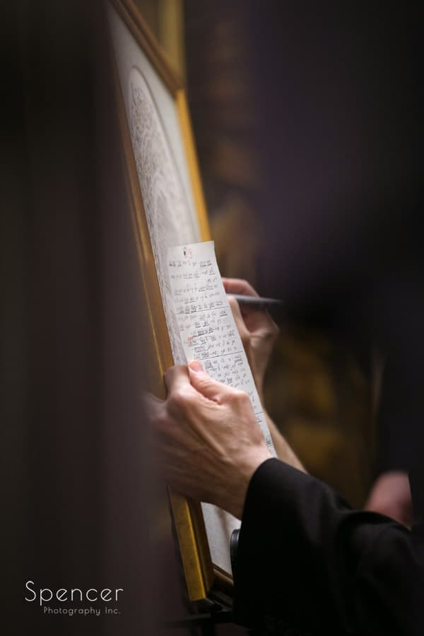 signing the ketubah at revere road synagogue wedding ceremony