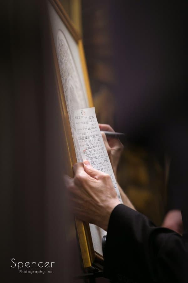 signing the ketubah at revere road synagogue wedding ceremony