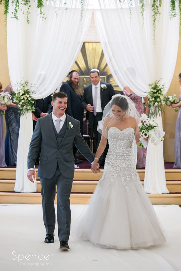 bride and groom recessional at revere road synagogue wedding