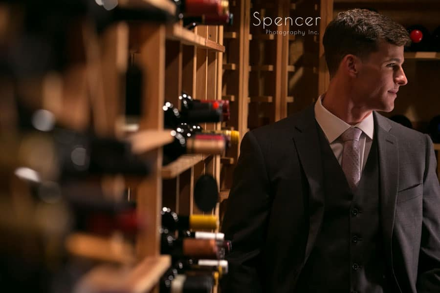 groom picture in wine cellar