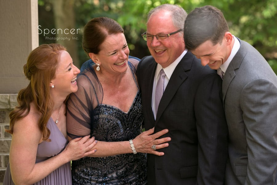 groom laughing with his family