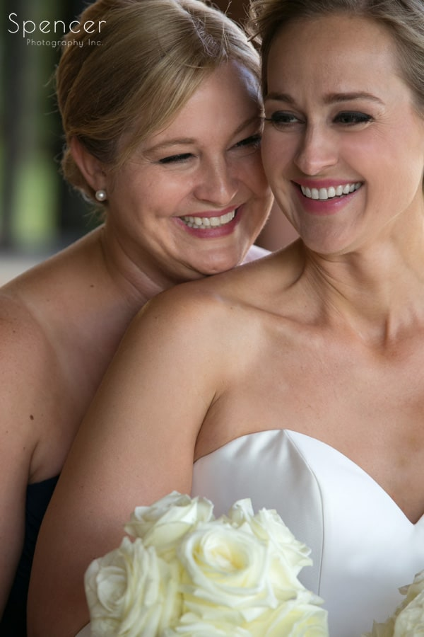bride laughing with her sister at firestone wedding