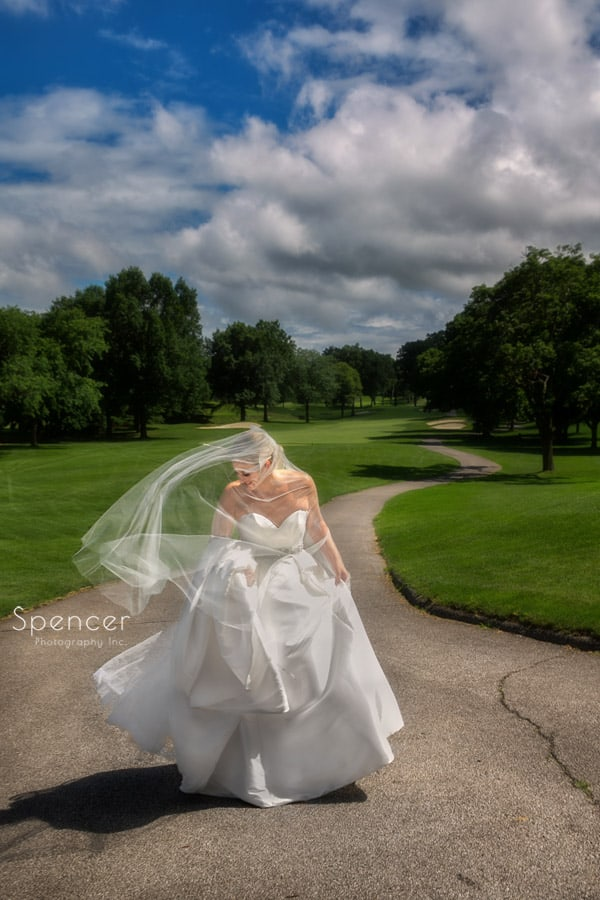 bride in flowing wedding dress at firestone country club