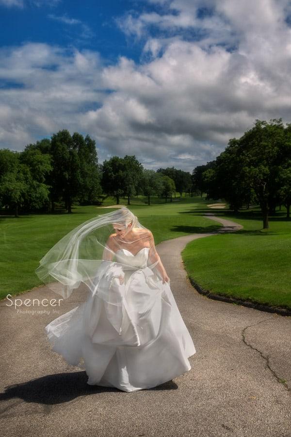 bride in flowing wedding dress at firestone country club