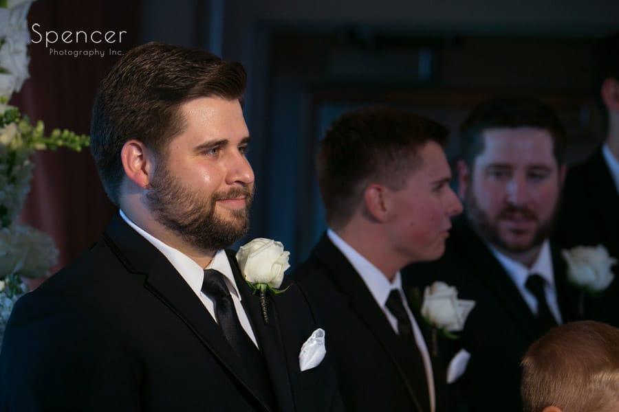 groom watching bride walk down aisle at firestone wedding