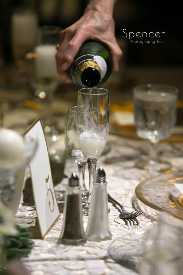champagne being poured at wedding reception at Akron Hilton
