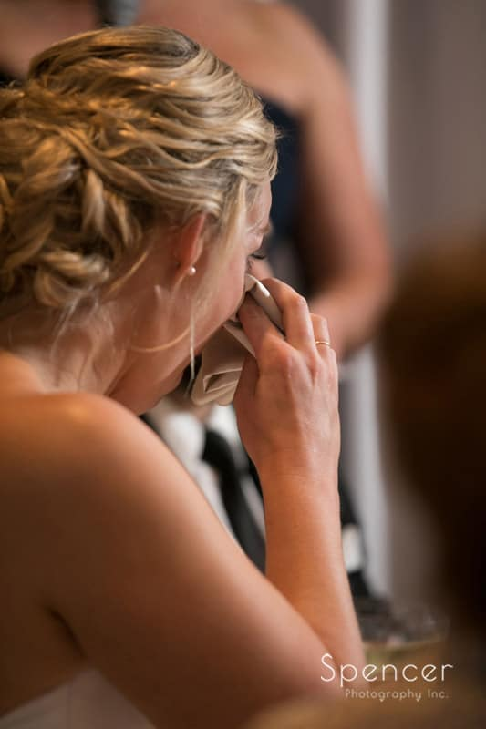 bride crying at her wedding reception