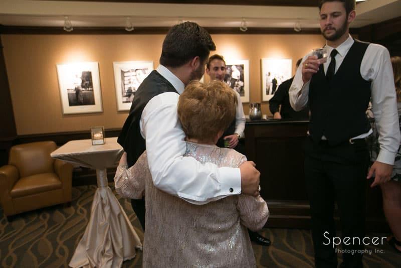 groom hugs grandma at firestone wedding reception