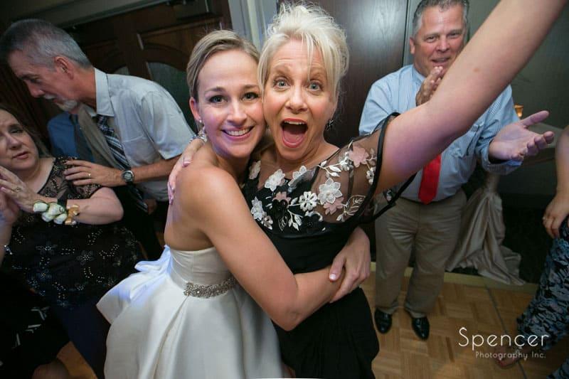 bride hugs wedding guest at firestone
