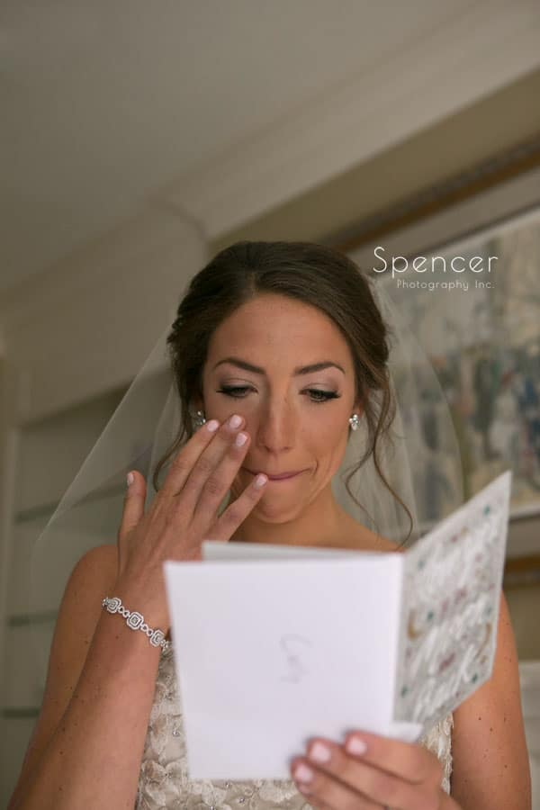 bride reads card from groom on wedding day