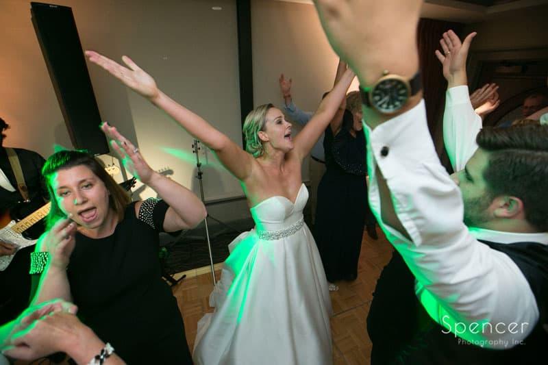 bride dancing at her wedding reception at firestone