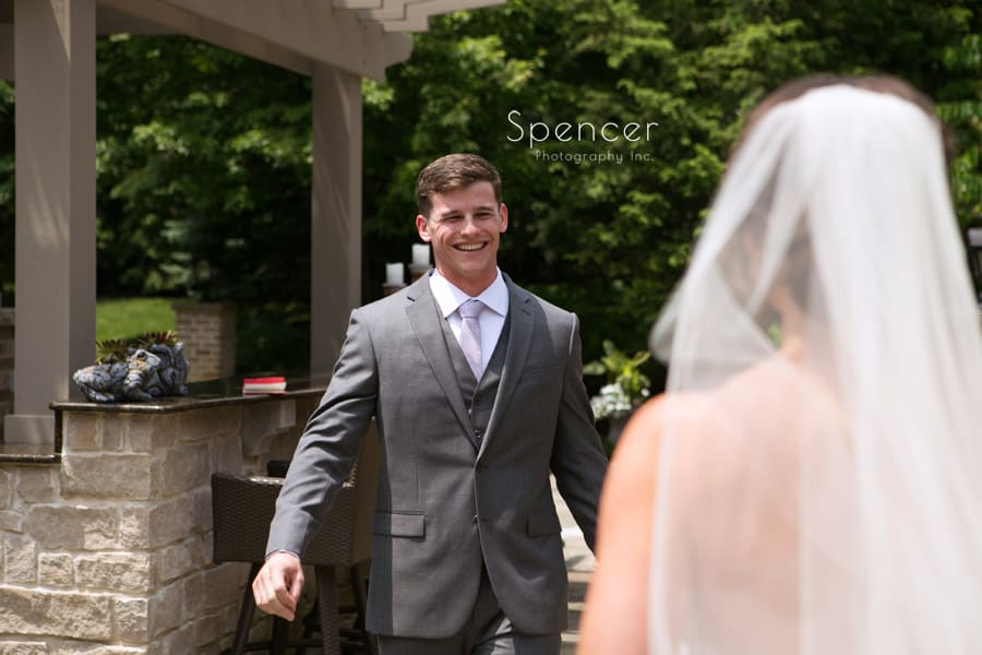 groom sees bride for first time on wedding day