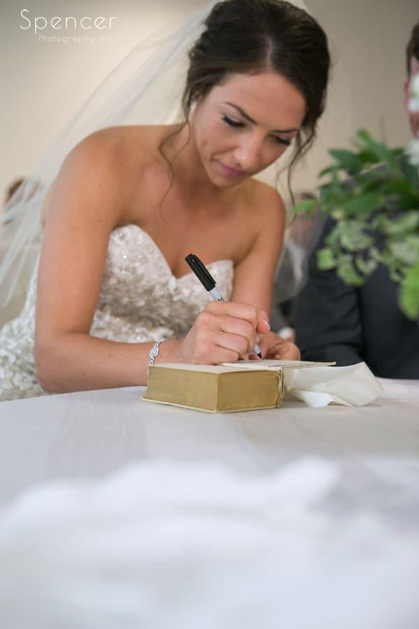 bride signing torah at revere road synagogue