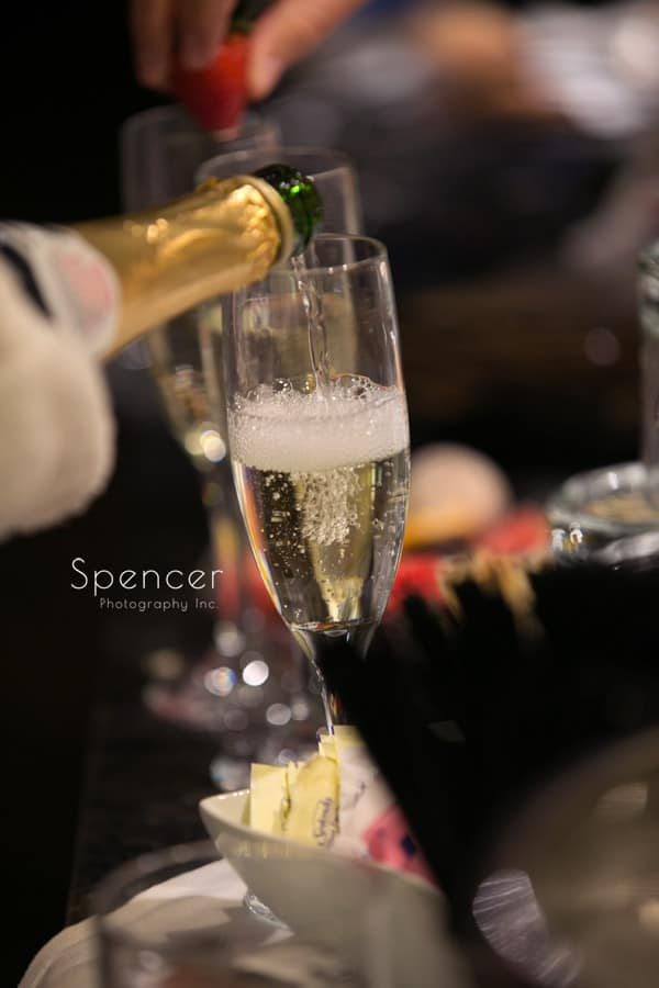 champagne being poured before wedding at Firestone Country Club