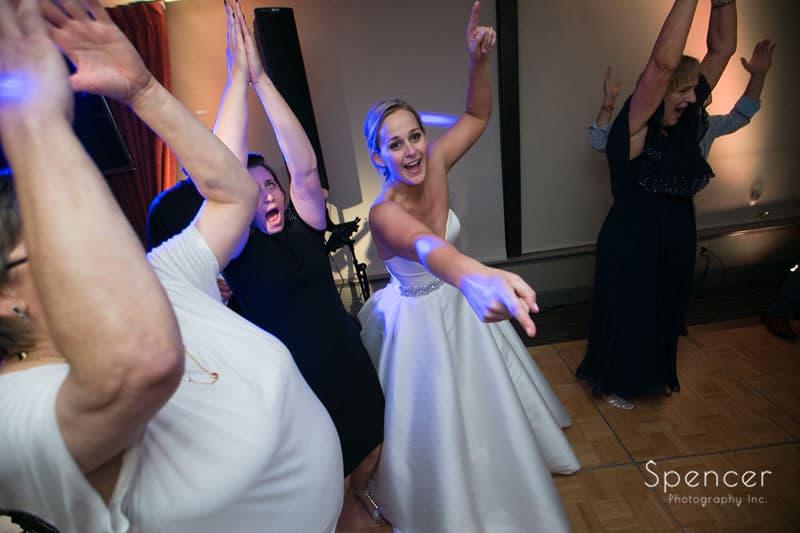 bride having fun at her wedding reception at firestone