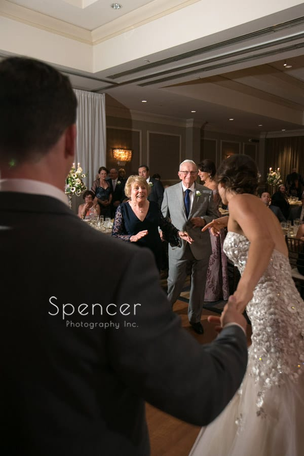 bride and groom dance with grandparents
