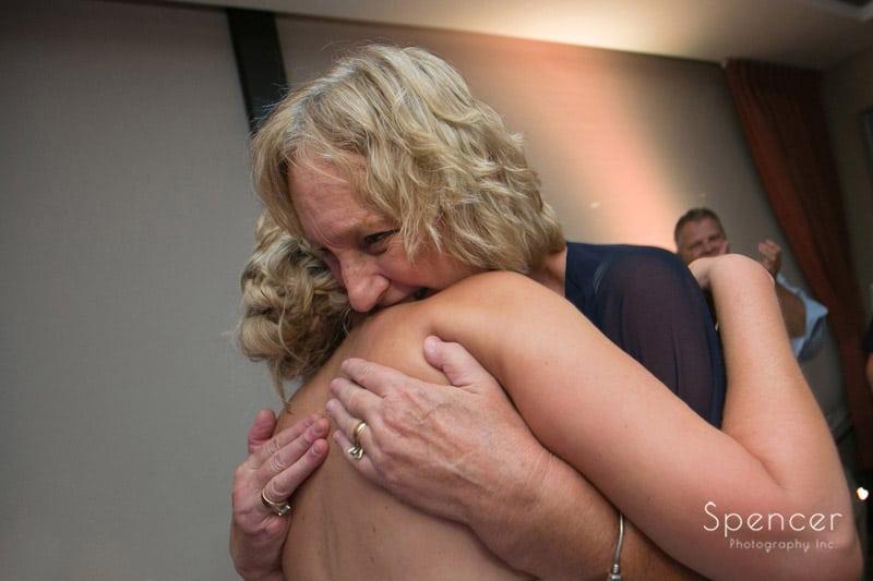 mother of bride hugging her