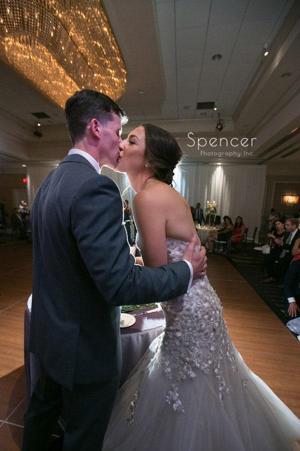 bride and groom kiss at reception at akron hilton