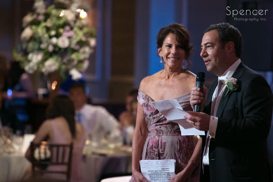 brides parents speak at reception at hilton