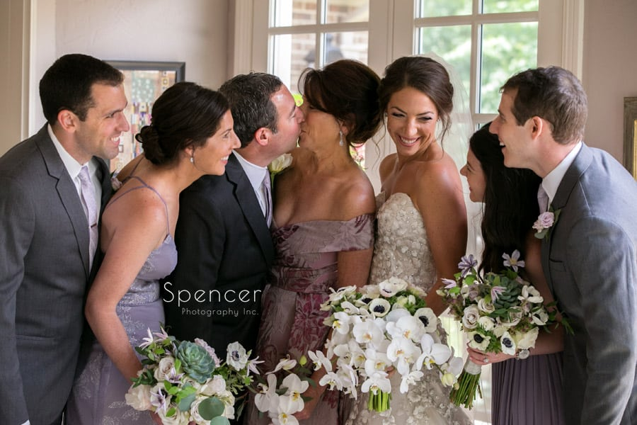 brides family laughing on wedding day