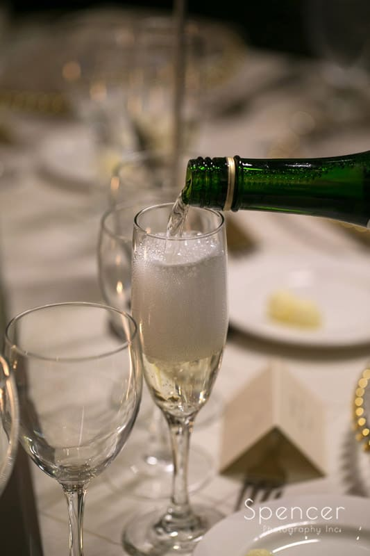 champagne being poured at firestone wedding reception