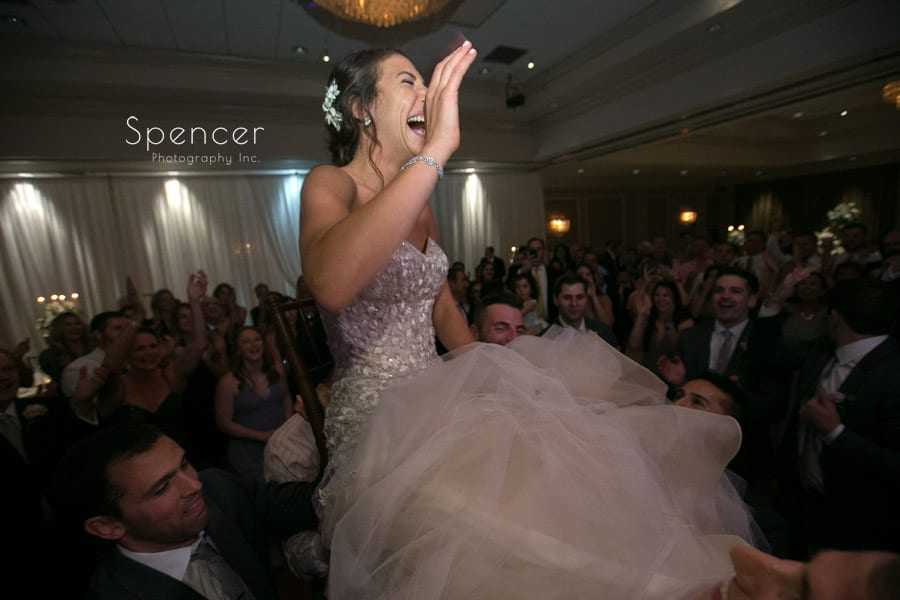 bride laughing during hora at akron hilton hotel reception