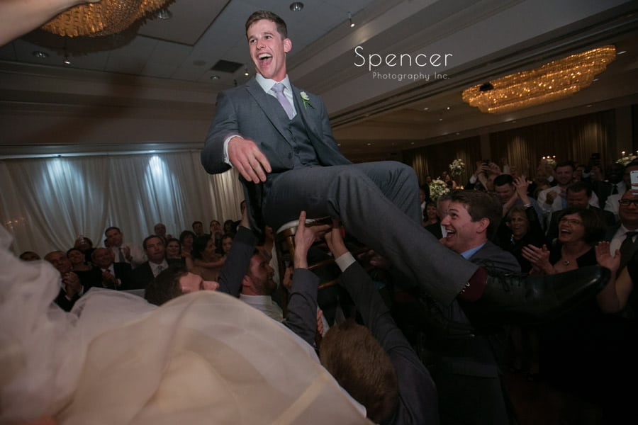 groom laughing during hora at akron hilton wedding reception