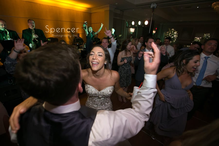 bride dancing with groom at wedding reception in akron