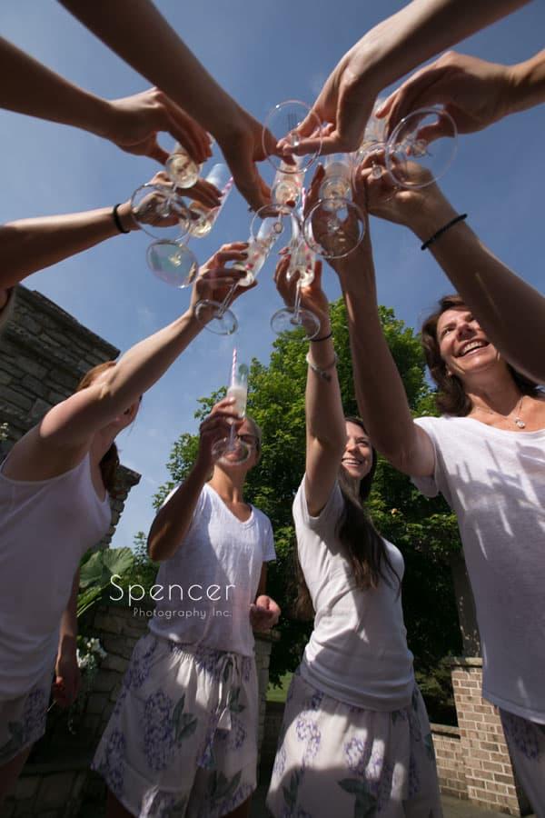 bridesmaids making a wedding day toast