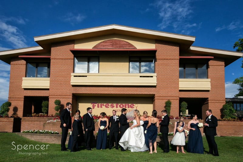 bridal party outside wedding reception at firestone country club