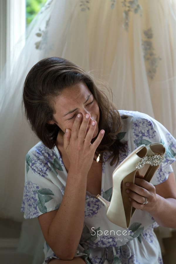 bride reacting to love not left by groom on her wedding shoes
