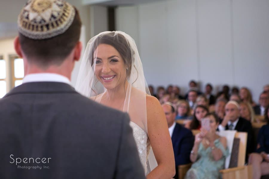 bride smiling at groom at revere road synagogue wedding