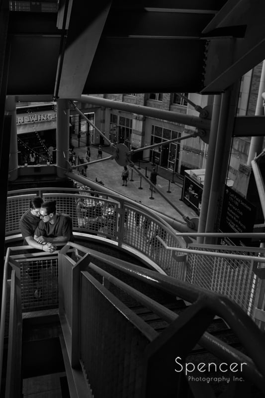 black and white engagement picture on stairs of progressive field