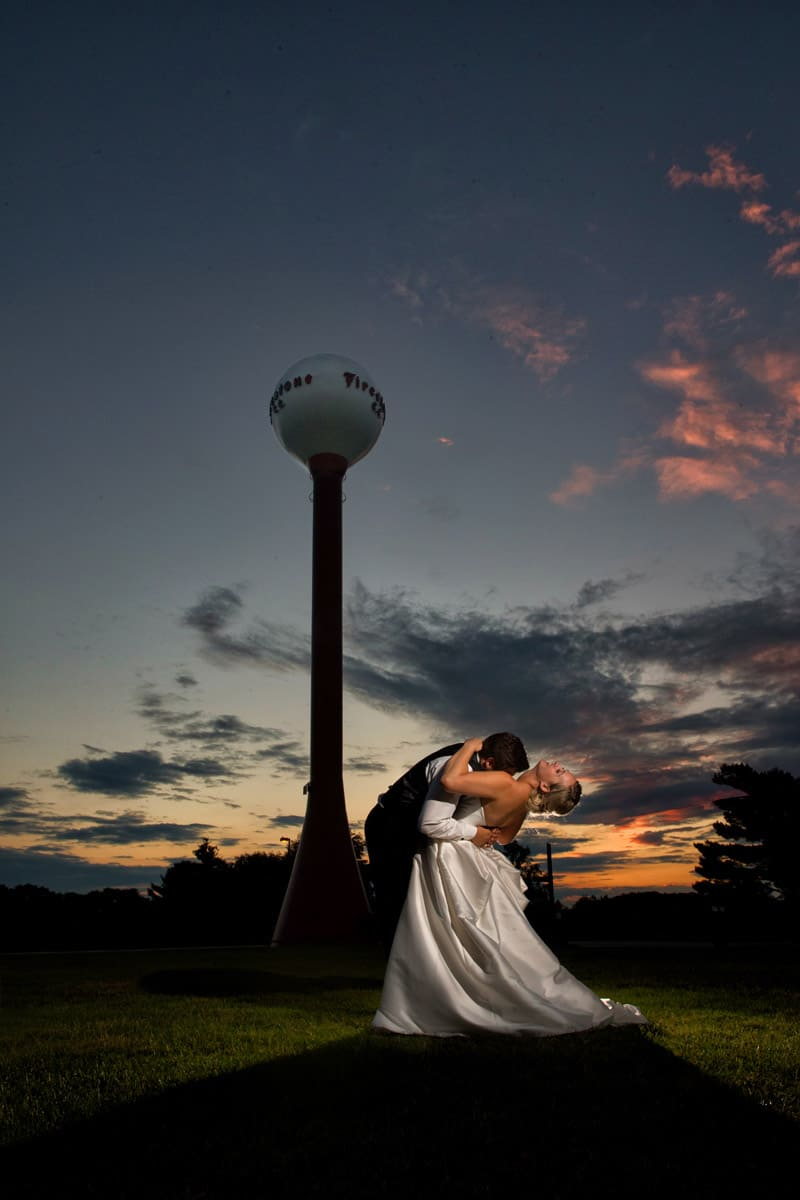 bride and groom kissing outside firestone country club wedding reception