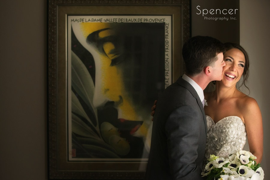 cleveland bride and groom kissing next to artwork