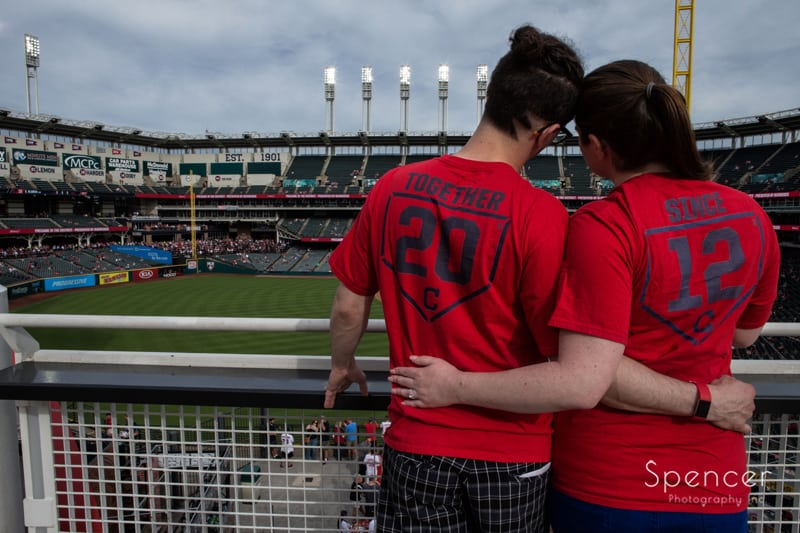 engagement picture from behind couple at cleveland progressive field