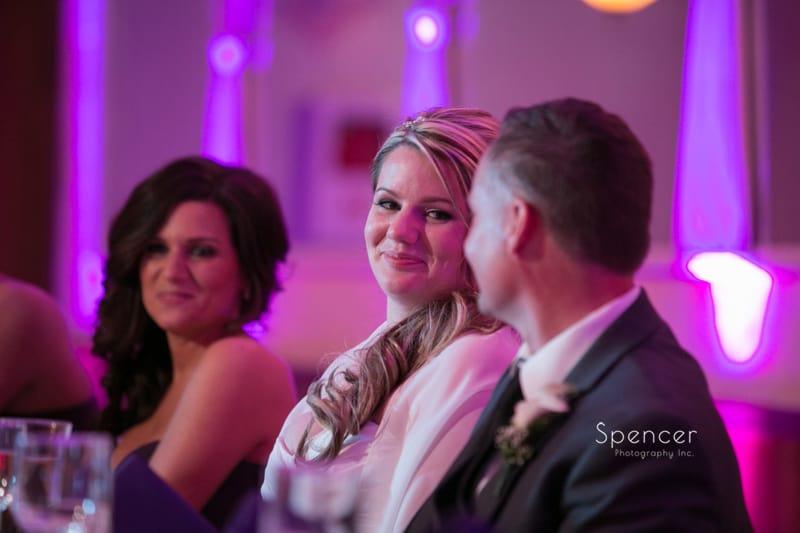 bride smiles at groom during wedding reception at Springvale Ballroom