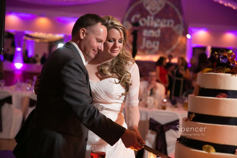 bride and groom cut their wedding cake at Springvale Ballroom