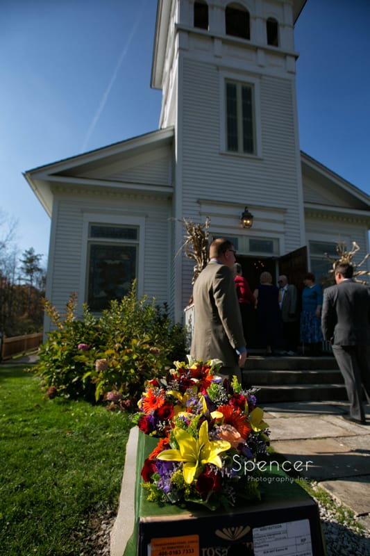 guests entering wedding ceremony at Frostville Church