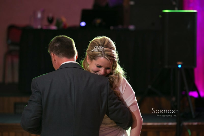 bride laughs during first dance at Springvale Ballroom wedding reception
