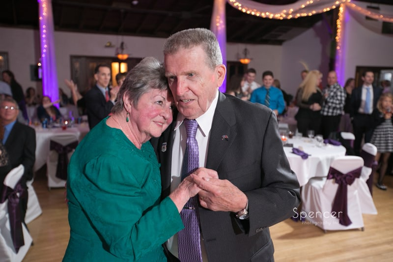 grandparents of bride danceing at her wedding reception