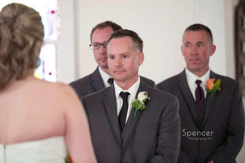 groom looking at bride during wedding at Frostville Chruch