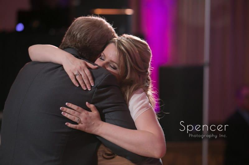 bride hugging dad at wedding reception at Springvale