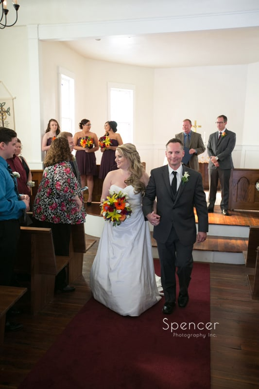 bride and groom walking down aisle at Frostville Church